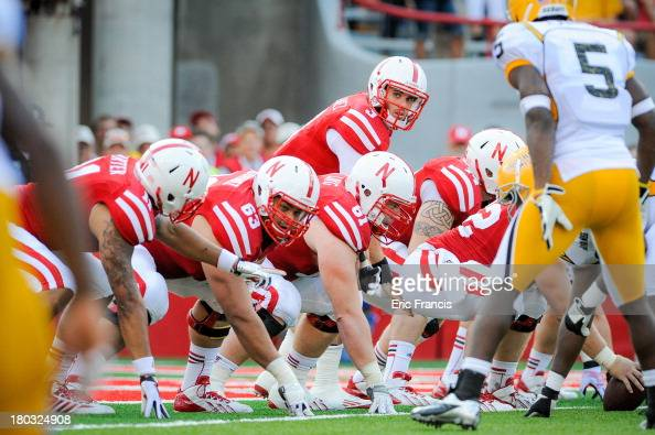 Quarterback Taylor Martinez of the Nebraska Cornhuskers and his offensive line prepare to snap the ball during their game against the Southern Miss...