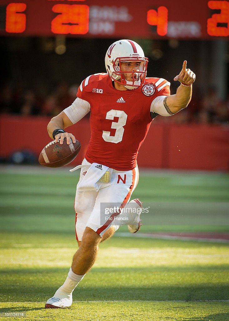 Quarterback <a gi-track='captionPersonalityLinkClicked' href=/galleries/search?phrase=Taylor+Martinez&family=editorial&specificpeople=7175179 ng-click='$event.stopPropagation()'>Taylor Martinez</a> #3 of the Nebraska Cornhuskers directs his offense against the Southern Miss Golden Eagles during their game at Memorial Stadium on September 1, 2012 in Lincoln, Nebraska. Nebraska won 40-20.