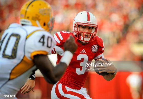 Quarterback Taylor Martinez of the Nebraska Cornhuskers eyes linebacker CJ Perry of the Southern Miss Golden Eagles during their game at Memorial...