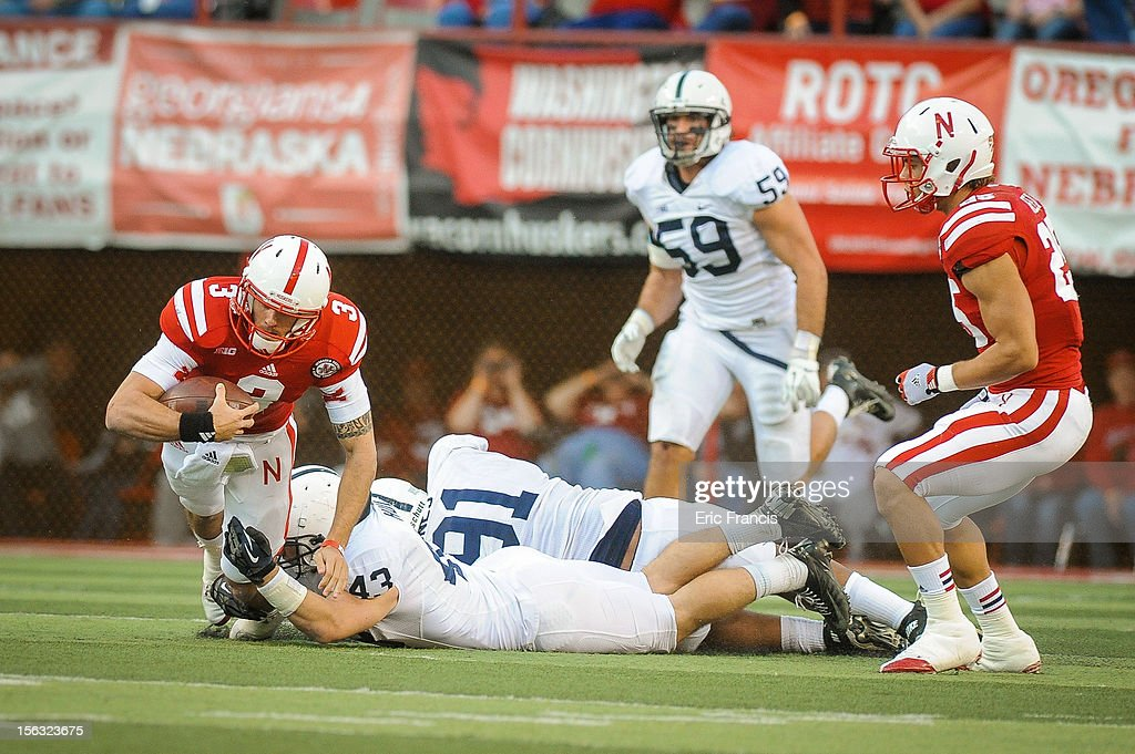 Quarterback Taylor Martinez #3 of the Nebraska Cornhuskers is tripped up by linebacker Mike Hull #43 of the Penn State Nittany Lions during their game at Memorial Stadium on November 10, 2012 in Lincoln, Nebraska. Nebraska beat Penn State 32-23.