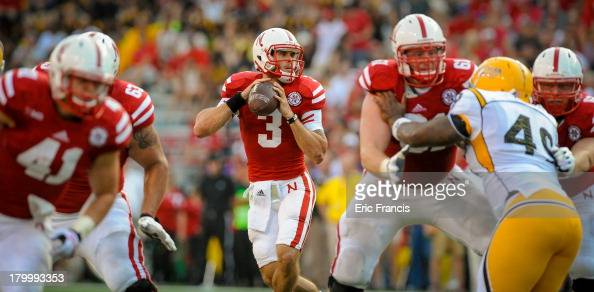 Quarterback Taylor Martinez of the Nebraska Cornhuskers looks down field against the Southern Miss Golden Eagles during their game at Memorial...