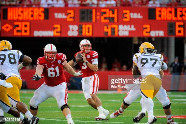 Quarterback Taylor Martinez of the Nebraska Cornhuskers looks down field over offensive linesman Spencer Long of the Nebraska Cornhuskers during...