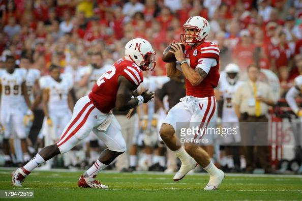 Quarterback Taylor Martinez of the Nebraska Cornhuskers looks downfield during their game against the Wyoming Cowboys at Memorial Stadium on August...