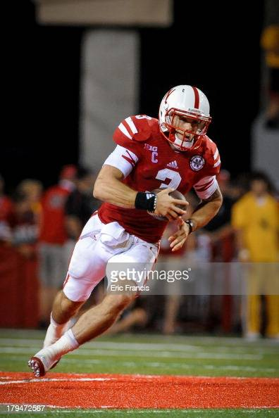 Quarterback Taylor Martinez of the Nebraska Cornhuskers runs down field during their game against the Wyoming Cowboys at Memorial Stadium on August...