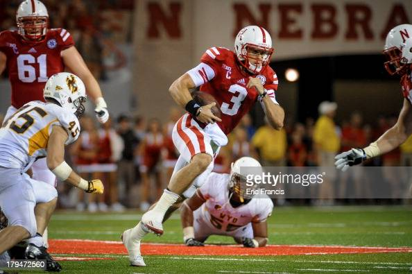 Quarterback Taylor Martinez of the Nebraska Cornhuskers runs through the Wyoming Cowboys during their game at Memorial Stadium on August 31 2013 in...