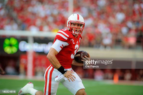 Quarterback Taylor Martinez of the Nebraska Cornhuskers scrambles during their game against the Southern Miss Golden Eagles at Memorial Stadium on...