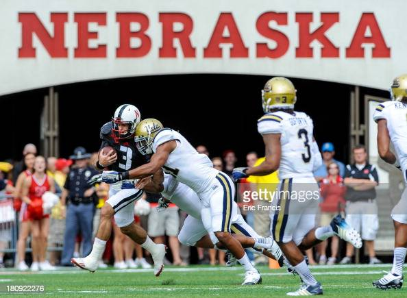 Quarterback Taylor Martinez of the Nebraska Cornhuskers takes a hit from linebacker Anthony Barr of the UCLA Bruins during their game at Memorial...