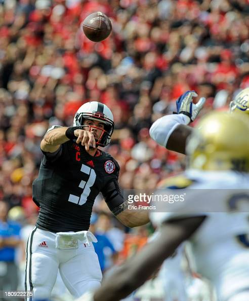 Quarterback Taylor Martinez of the Nebraska Cornhuskers throws down field during their game against the UCLA Bruins at Memorial Stadium on September...