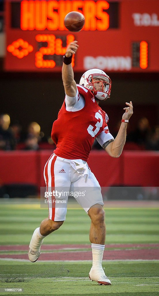 Quarterback <a gi-track='captionPersonalityLinkClicked' href=/galleries/search?phrase=Taylor+Martinez&family=editorial&specificpeople=7175179 ng-click='$event.stopPropagation()'>Taylor Martinez</a> #3 of the Nebraska Cornhuskers throws downfield over the Minnesota Golden Gophers defense during their game at Memorial Stadium on November 17, 2012 in Lincoln, Nebraska.