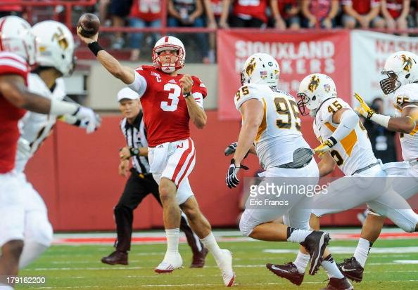 Quarterback Taylor Martinez of the Nebraska Cornhuskers throws over the Wyoming Cowboys during their game at Memorial Stadium on August 31 2013 in...