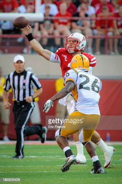 Quarterback Taylor Martinez of the Nebraska Cornhuskers throws over defensive back Debarriaus Miller of the Southern Miss Golden Eagles during their...