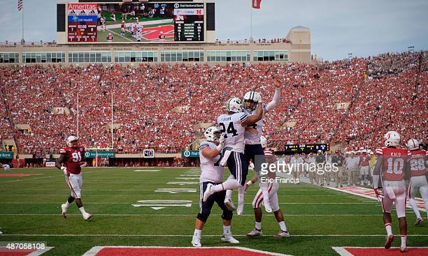 Quarterback Taysom Hill and running back Algernon Brown of the Brigham Young Cougars celebrate a touchdown during their game against the Nebraska...