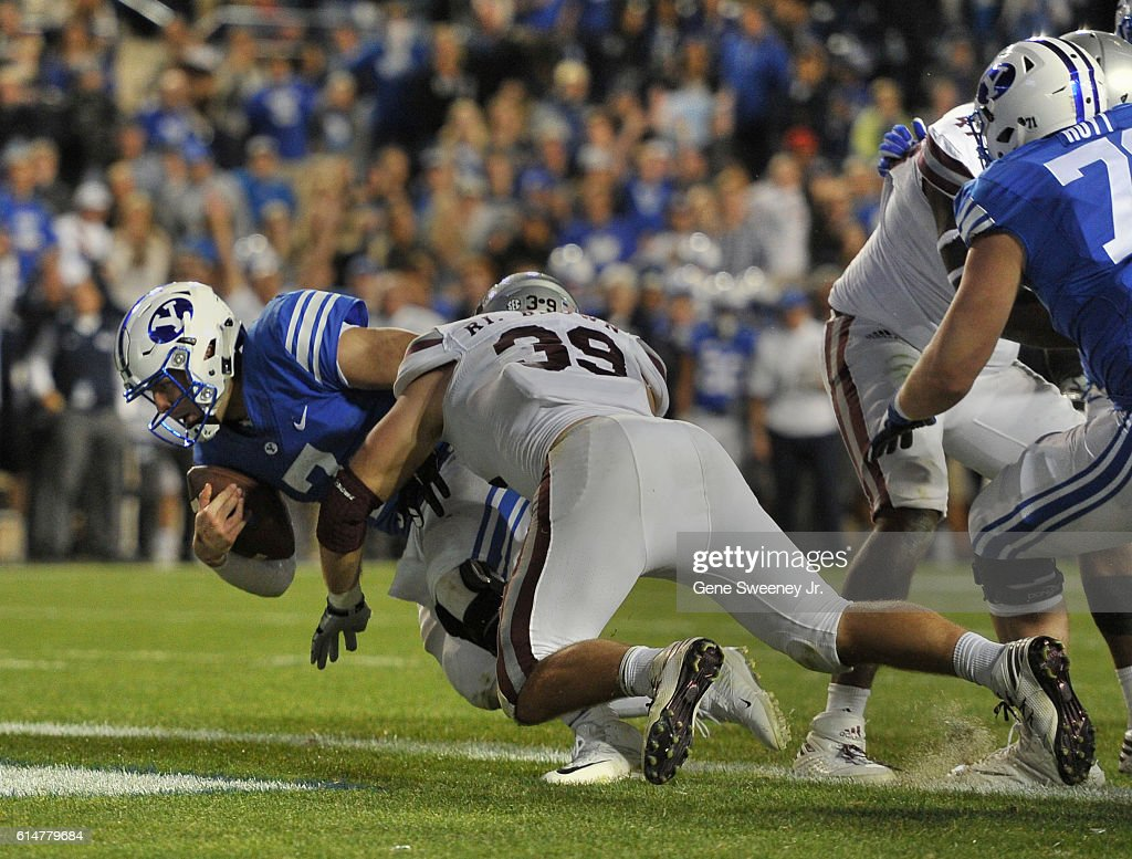 Quarterback Taysom Hill #7 of the Brigham Young Cougars scores a touchdown in the first overtime period past defender Sean Samuel #93 of the Mississippi State Bulldogs at LaVell Edwards Stadium on October 14, 2016 in Provo Utah. The Brigham Young Cougars won in double overtime 28-21.