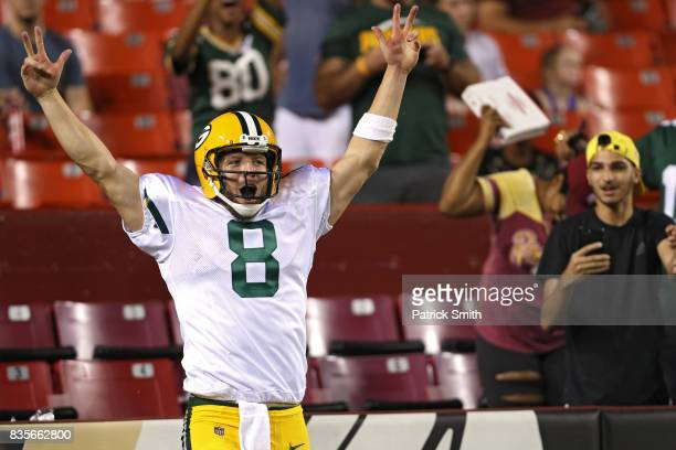 Quarterback Taysom Hill of the Green Bay Packers celebrates after rushing for a touchdown against the Washington Redskins in the fourth quarter...