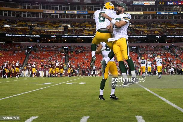 Quarterback Taysom Hill of the Green Bay Packers celebrates after rushing for a touchdown with teammate Aaron Rodgers against the Washington Redskins...