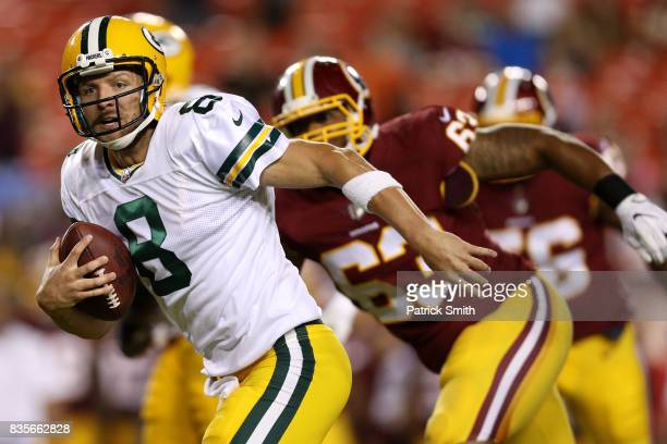 Quarterback Taysom Hill of the Green Bay Packers rushes for a touchdown against the Washington Redskins in the fourth quarter during a preseason game...