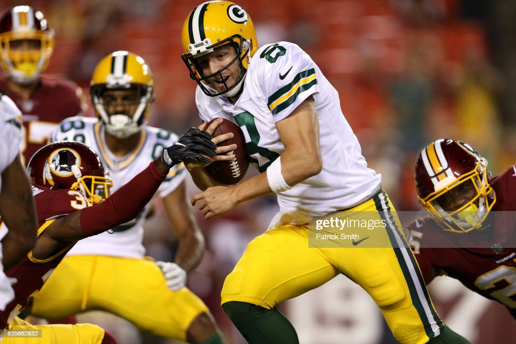 Quarterback Taysom Hill #8 of the Green Bay Packers rushes for a touchdown against the Washington Redskins in the fourth quarter during a preseason game at FedExField on August 19, 2017 in Landover, Maryland.