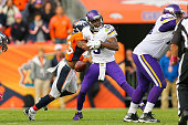 Quarterback Teddy Bridgewater of the Minnesota Vikings has the ball stripped by strong safety TJ Ward of the Denver Broncos to end the game in favor...