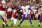 Quarterback Teddy Bridgewater of the Minnesota Vikings has the ball knocked free by inside linebacker Dwight Freeney of the Arizona Cardinals during...
