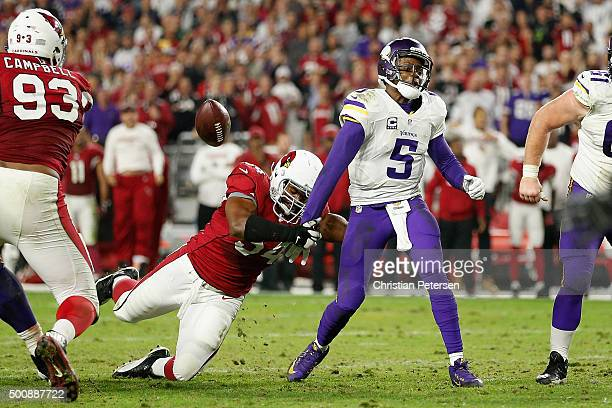 Quarterback Teddy Bridgewater of the Minnesota Vikings has the ball knocked free by inside linebacker Dwight Freeney of the Arizona Cardinals during...