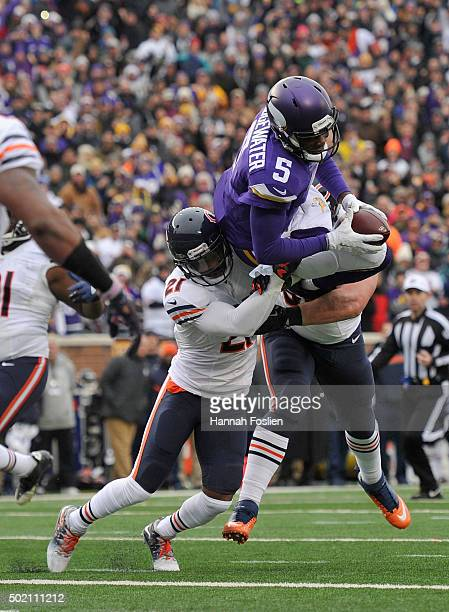 Quarterback Teddy Bridgewater of the Minnesota Vikings scores a touchdown against Ryan Mundy of the Chicago Bears during the fourth quarter of the...
