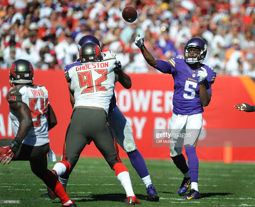 Quarterback Teddy Bridgewater #5 of the Minnesota Vikings throws a pass against the Tampa Bay Buccaneers in the fourth quarter at Raymond James Stadium on October 26, 2014 in Tampa, Florida.