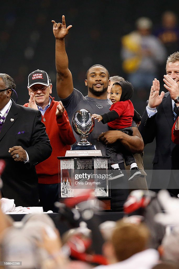 Quarterback Terrance Broadway #8 of the Louisiana-Lafayette Ragin Cajuns celebrates after defeating the East Carolina Pirates 43-34 during the R+L Carriers New Orleans Bow at the Mercedes-Benz Superdome on December 22, 2012 in New Orleans, Louisiana.