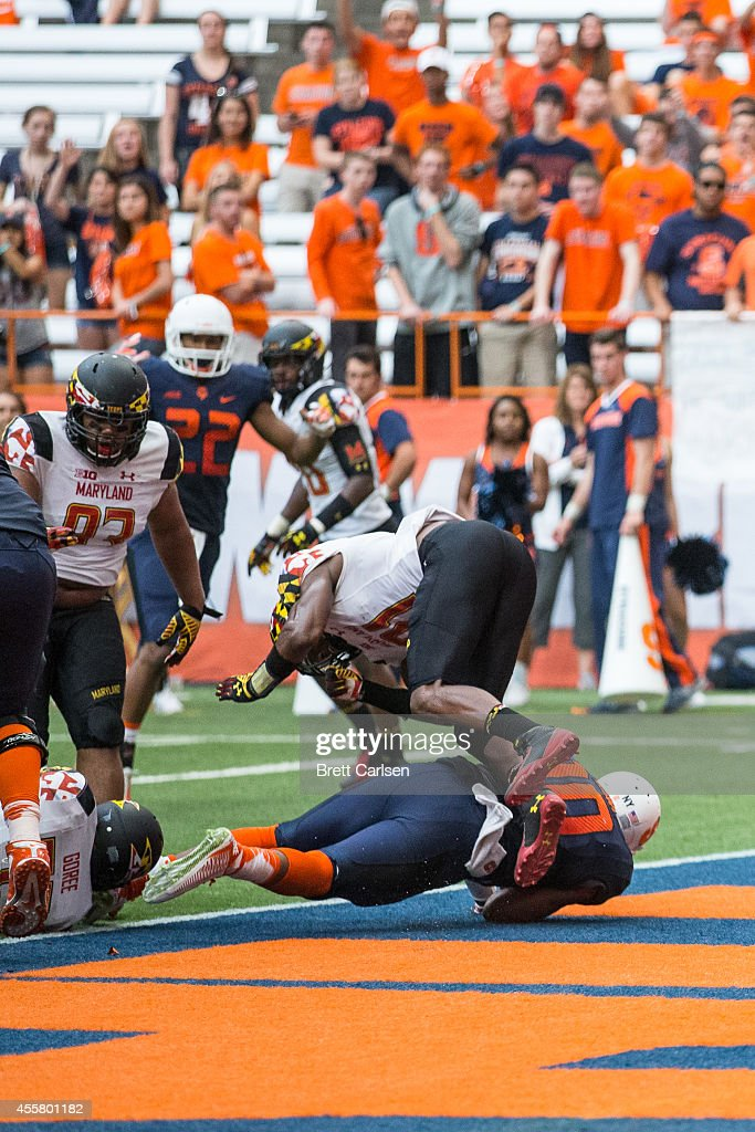 quarterback Terrel Hunt #10 of the Syracuse Orange runs the ball in for Syracuse's final touchdown during the fourth quarter against the Maryland Terrapins on September 20, 2014 at The Carrier Dome in Syracuse, New York. Maryland defeats Syracuse 34-20.