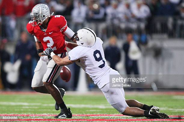 Quarterback Terrell Pryor of the Ohio State Buckeyes fumbles the ball after being hit by defensive back Mark Rubin of the Penn State Nittany Lions on...