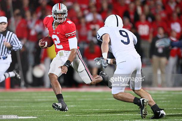 Quarterback Terrell Pryor of the Ohio State Buckeyes looks for running room as defensive back Mark Rubin of the Penn State Nittany Lions defends in...