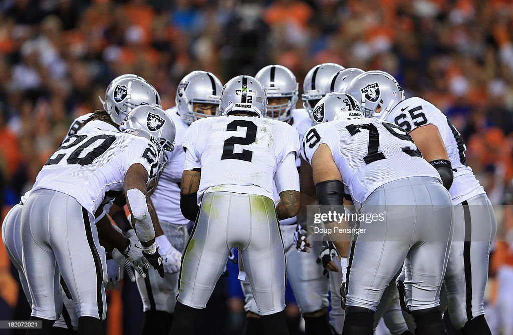 Quarterback <a gi-track='captionPersonalityLinkClicked' href=/galleries/search?phrase=Terrelle+Pryor&family=editorial&specificpeople=4420918 ng-click='$event.stopPropagation()'>Terrelle Pryor</a> #2 of the Oakland Raiders runs the huddle against the Denver Broncos at Sports Authority Field at Mile High on September 23, 2013 in Denver, Colorado.