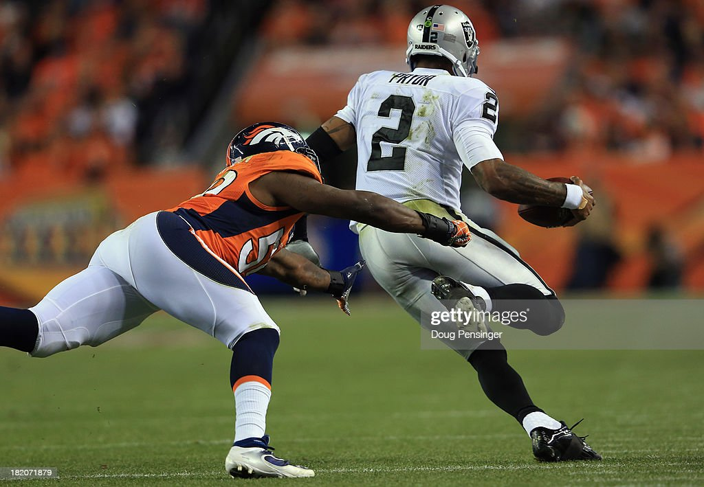 Quarterback <a gi-track='captionPersonalityLinkClicked' href=/galleries/search?phrase=Terrelle+Pryor&family=editorial&specificpeople=4420918 ng-click='$event.stopPropagation()'>Terrelle Pryor</a> #2 of the Oakland Raiders scrambles and eludes <a gi-track='captionPersonalityLinkClicked' href=/galleries/search?phrase=Danny+Trevathan&family=editorial&specificpeople=6475347 ng-click='$event.stopPropagation()'>Danny Trevathan</a> #59 of the Denver Broncos at Sports Authority Field at Mile High on September 23, 2013 in Denver, Colorado.