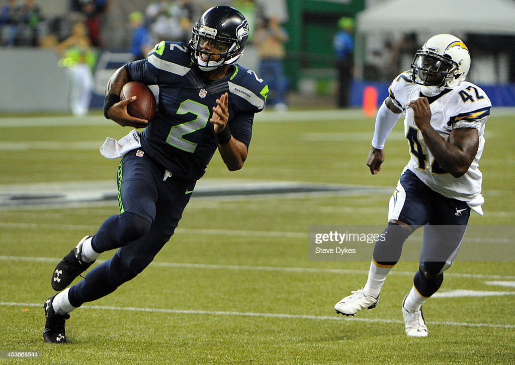 Quarterback <a gi-track='captionPersonalityLinkClicked' href=/galleries/search?phrase=Terrelle+Pryor&family=editorial&specificpeople=4420918 ng-click='$event.stopPropagation()'>Terrelle Pryor</a> #2 of the Seattle Seahawks runs for a touchdown during the fourth quarter of the game against the San Diego Chargers at CenturyLink Field on August 15, 2014 in Seattle,Wa.