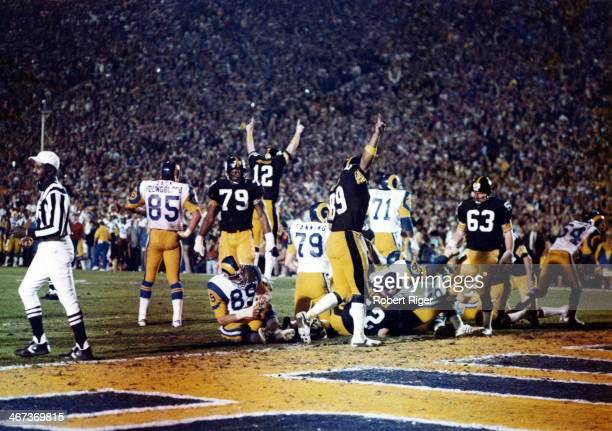 Quarterback Terry Bradshaw of the Pittsburgh Steelers along with other teammates celebrate after scoring a touchdown during Super Bowl XIV against...