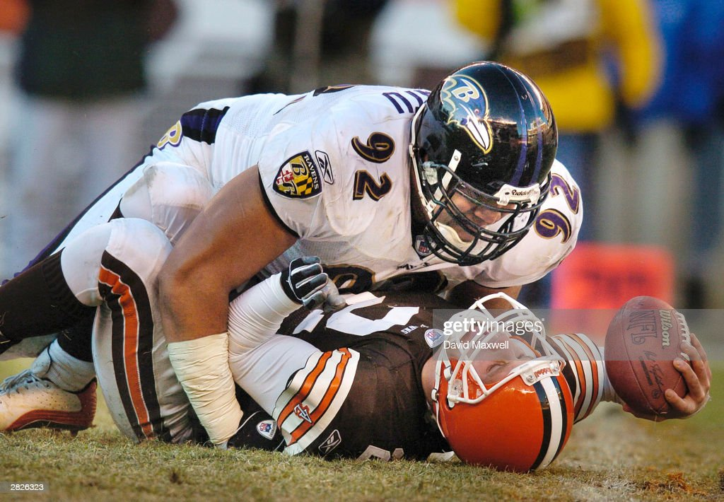 Quarterback Tim Couch of the Cleveland Browns is sacked by Maake Kemoeatu of the Baltimore Ravens during the fourth quarter on December 21 2003 at...