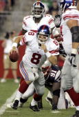 Quarterback Tim Hasselbeck of the New York Giants scrambles to avoid a sack against the New England Patriots during their preseason game at Gillette...