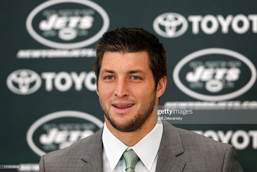 Quarterback Tim Tebow addresses the media as he is introduced as a New York Jet at the Atlantic Health Jets Training Center on March 26, 2012 in Florham Park, New Jersey. Tebow, traded from the Denver Broncos last week, will be the team's backup quarterback according to Jets head coach Rex Ryan. Tebow, the 2007 Heisman Trophy winner, started 11 games in 2011 for Denver and finished with a 7-4 record as a starter. He led the Broncos to a playoff overtime win against the Pittsburgh Steelers in the first round before eventually losing to the New England Patriots in the next round.
