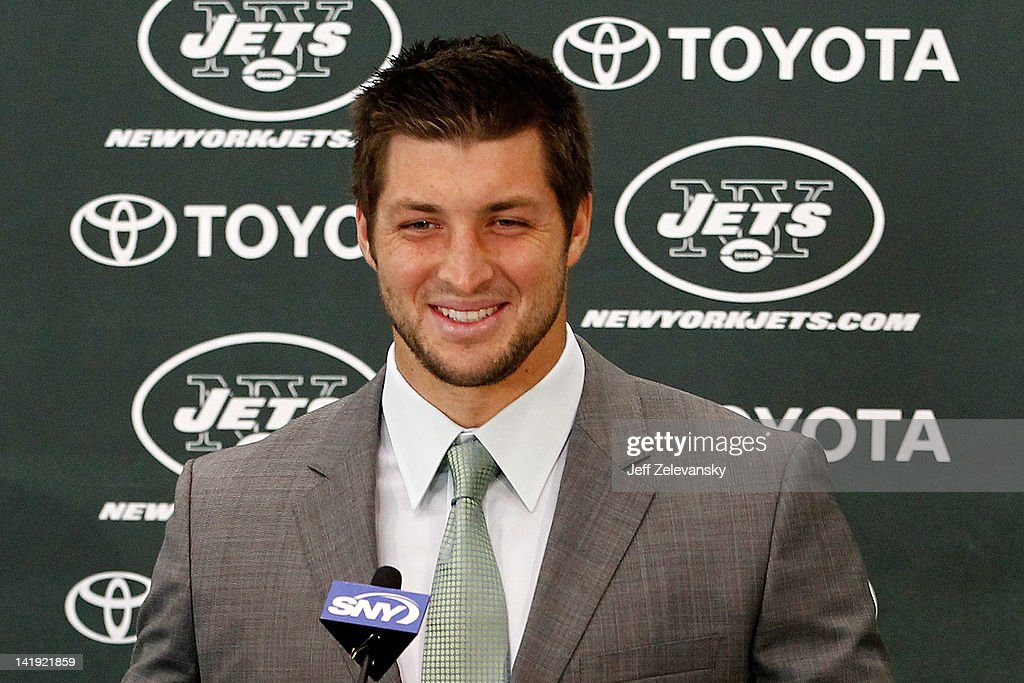 Quarterback <a gi-track='captionPersonalityLinkClicked' href=/galleries/search?phrase=Tim+Tebow&family=editorial&specificpeople=2729658 ng-click='$event.stopPropagation()'>Tim Tebow</a> addresses the media as he is introduced as a New York Jet at the Atlantic Health Jets Training Center on March 26, 2012 in Florham Park, New Jersey. Tebow, traded from the Denver Broncos last week, will be the team's backup quarterback according to Jets head coach Rex Ryan. Tebow, the 2007 Heisman Trophy winner, started 11 games in 2011 for Denver and finished with a 7-4 record as a starter. He led the Broncos to a playoff overtime win against the Pittsburgh Steelers in the first round before eventually losing to the New England Patriots in the next round.