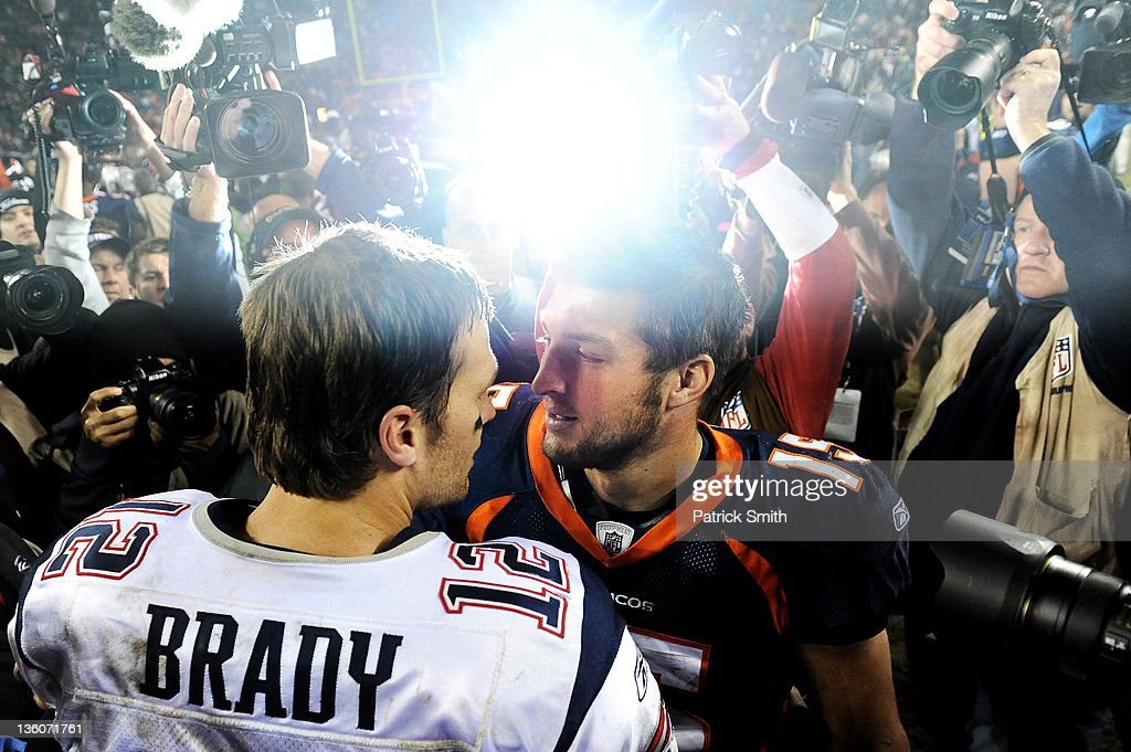 Quarterback <a gi-track='captionPersonalityLinkClicked' href=/galleries/search?phrase=Tim+Tebow&family=editorial&specificpeople=2729658 ng-click='$event.stopPropagation()'>Tim Tebow</a> #15 of the Denver Broncos and quarterback <a gi-track='captionPersonalityLinkClicked' href=/galleries/search?phrase=Tom+Brady+-+American+Football+Quarterback&family=editorial&specificpeople=201737 ng-click='$event.stopPropagation()'>Tom Brady</a> #12 of the New England Patriots shake hands after an NFL game at Sports Authority Field at Mile High on December 18, 2011 in Denver, Colorado. The New England Patriots won, 41-23.