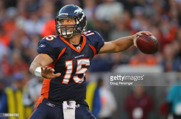 Quarterback Tim Tebow of the Denver Broncos delivers a pass against the New England Patriots at Sports Authority Field at Mile High on December 18...