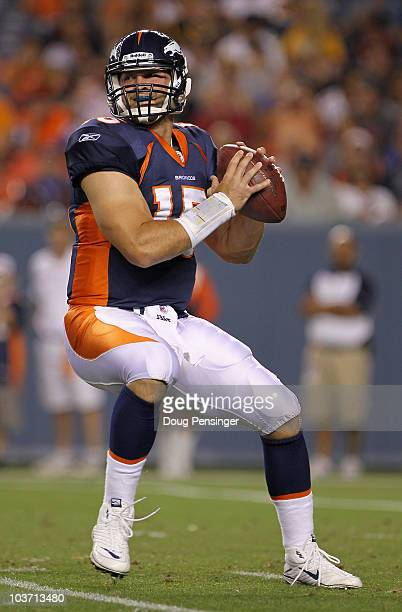 Quarterback Tim Tebow of the Denver Broncos drops back to pass against the Pittsburgh Steelers during preseason NFL action at INVESCO Field at Mile...