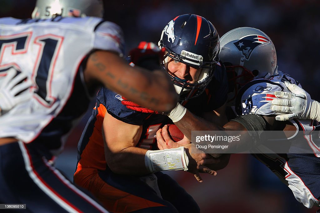Quarterback <a gi-track='captionPersonalityLinkClicked' href=/galleries/search?phrase=Tim+Tebow&family=editorial&specificpeople=2729658 ng-click='$event.stopPropagation()'>Tim Tebow</a> of the Denver Broncos is tackled by strong safety James Ihedigbo #44 of the New England Patriots at Sports Authority Field at Mile High on December 18, 2011 in Denver, Colorado.