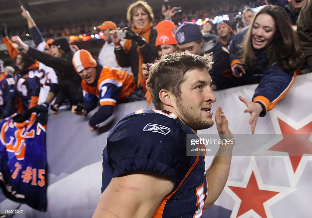 Quarterback Tim Tebow #15 of the Denver Broncos receives high fives from fans after defeating the Pittsburgh Steelers in overtime of the AFC Wild Card Playoff game at Sports Authority Field at Mile High on January 8, 2012 in Denver, Colorado. The Broncos defeated the Steelers in overtime 23-29.