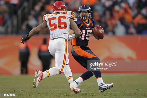 Quarterback Tim Tebow of the Denver Broncos scrambles and tries to elude linebacker Derrick Johnson of the Kansas City Chiefs at Sports Authority...