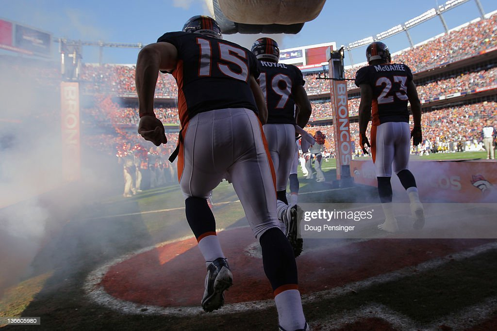 Quarterback <a gi-track='captionPersonalityLinkClicked' href=/galleries/search?phrase=Tim+Tebow&family=editorial&specificpeople=2729658 ng-click='$event.stopPropagation()'>Tim Tebow</a> #15 of the Denver Broncos takes the field along with teammates <a gi-track='captionPersonalityLinkClicked' href=/galleries/search?phrase=Eddie+Royal&family=editorial&specificpeople=2132149 ng-click='$event.stopPropagation()'>Eddie Royal</a> #19 and <a gi-track='captionPersonalityLinkClicked' href=/galleries/search?phrase=Willis+McGahee&family=editorial&specificpeople=202895 ng-click='$event.stopPropagation()'>Willis McGahee</a> #23 to face the Pittsburgh Steelers at Sports Authority Field at Mile High on January 8, 2012 in Denver, Colorado. The Broncos defeated the Steelers 29-23 in overtime.