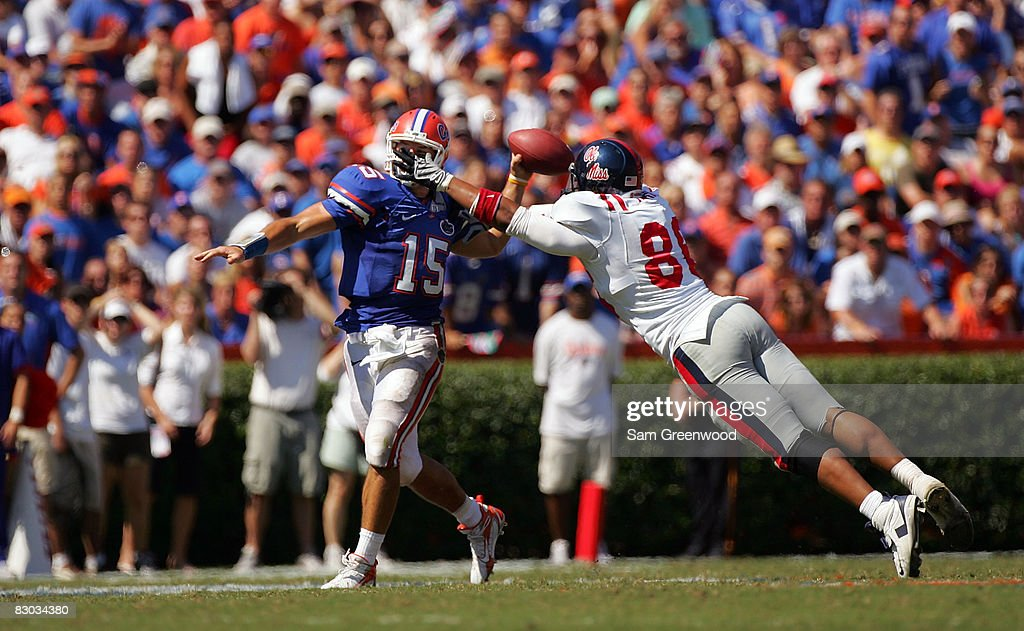 Quarterback Tim Tebow of the Florida Gators is pressured by Greg Hardy of the Ole Miss Rebels during the game at Ben Hill Griffin Stadium on...