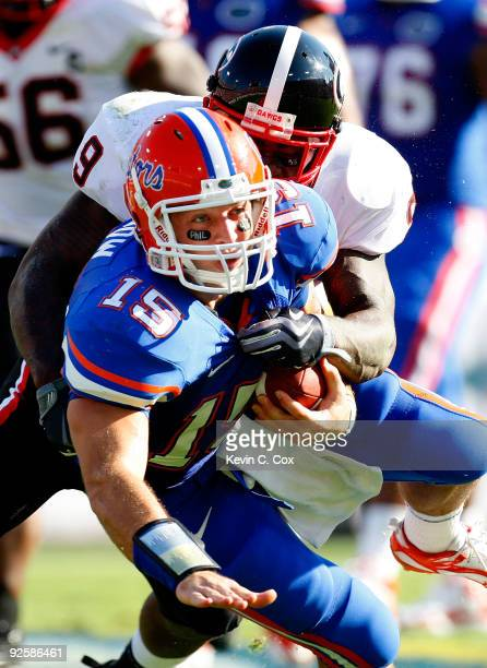 Quarterback Tim Tebow of the Florida Gators is tackled by Reshad Jones of the Georgia Bulldogs at Jacksonville Municipal Stadium on October 31 2009...
