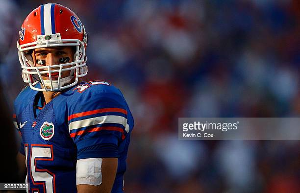 Quarterback Tim Tebow of the Florida Gators looks over the defense of the Georgia Bulldogs at Jacksonville Municipal Stadium on October 31 2009 in...