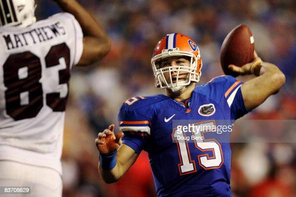 Quarterback Tim Tebow of the Florida Gators throws a touchdown pass in the fourth quarter over defensive end Cliff Matthews of the South Carolina...