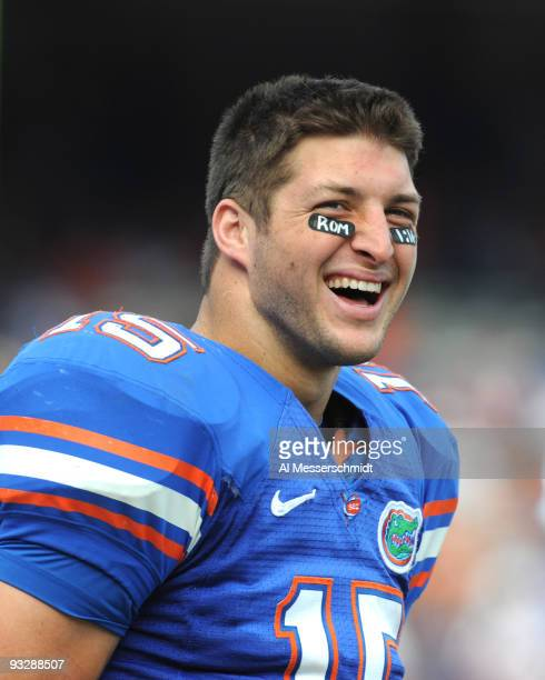 Quarterback Tim Tebow of the Florida Gators watches fourthquarter play against the Florida International University Golden Panthers November 21 2009...